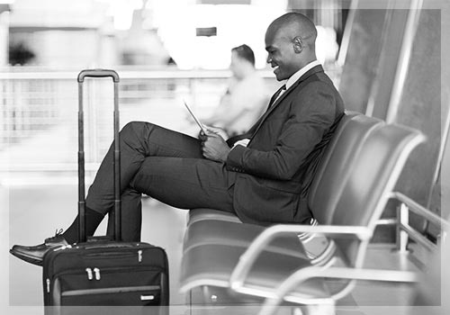 A man waiting for his airport transportation